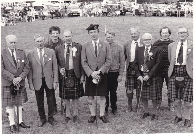 "Games Officials 1980's. The 1980s officials are Bert Rattray, Jim Jackson, Andrew Duncan, Robin Andrew, Sir Michael Nairn, James ""Woody"" Cameron, Bill McLauchlan, ""Ginger"" Bernier, Donald Michie and Aldo Campbell."