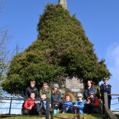 The children at the memorial, which is now overgrown with ivy (compare with black & white photo of memorial  from c. 1920). There is also not much room for parties to pay their respects.
