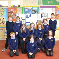 The pupils who took part, in front of the display they created.