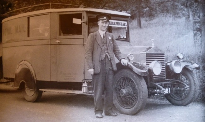Late 1940's mail bus seen with regular driver Willie Slidders.