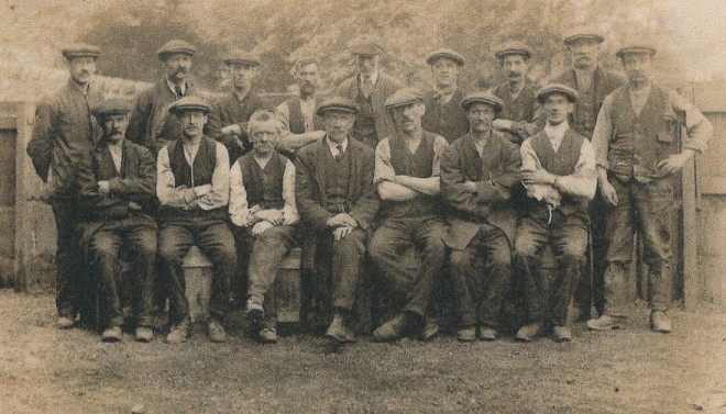 A group of working men - does anyone know who or where?