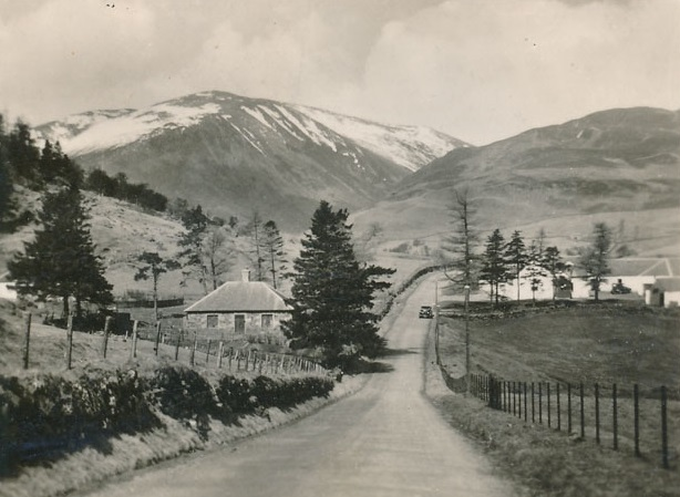 A view of Slochnacraig Farmhouse and Slochnacraig Cottage with Ben Gulabin in the background.