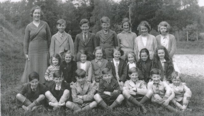 Pupils who attended Kirkmichael School 1936 with a young Miss McGregor who is mentioned with awe and trepidation by those who remember her.